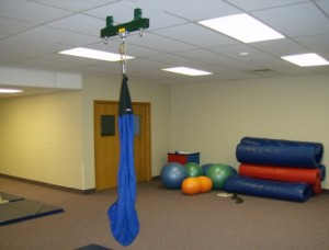 A physical therapy swing using Unistrut supports