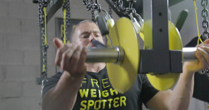 free weight spotter suspending dumbells